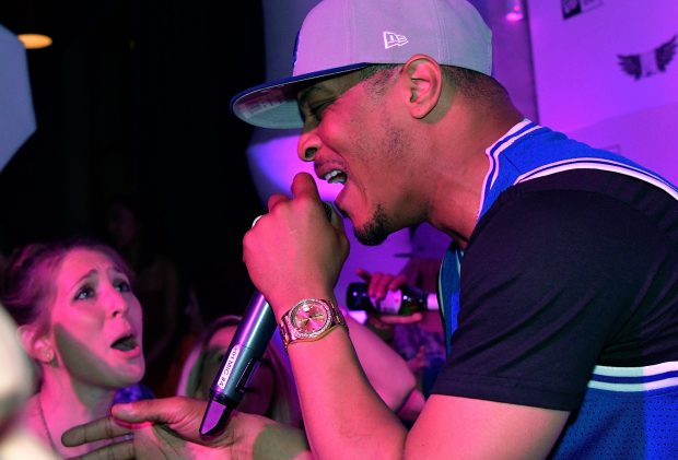 """""""CHARLOTTE, NC - MAY 20:  Rapper T.I. performs during the """"New Era Cap Celebrates NASCAR All-Star Weekend"""" event on May 20, 2016 in Charlotte, North Carolina.  (Photo by Grant Halverson/Getty Images for New Era Cap)"""""""